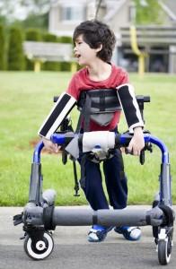 Small cerebral palsy boy walker.jpg