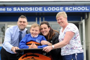 LAKE DISTRICT FARMERS JOE MORGAN   Lake District Farmers cheque presentation to Joe Morgan Pictured:  (l-R) CN group editor James Higgins, Joe Morgan Jo's mum Lianne Morgan and Janine Gray Senior teaching assistant at Sandside School, Ulverston, Thursday 29th June 2017 LEANNE BOLGER